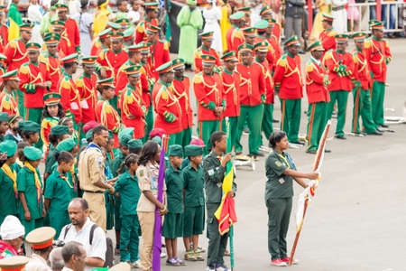 invading: Addis Ababa  May 5: Men Women and Children in colourful uniforms attend the 74th anniversary of Patriots Victory day commemorating the defeat of the invading Italians on May 5 2015 in Addis Ababa Ethiopia. Editorial