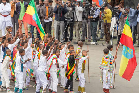invading: Addis Ababa  May 5: Young children dressed in colourful traditional outfit perform in front of the Ethiopian President at the 74th anniversary of Patriots Victory day commemorating the defeat of the invading Italians on May 5 2015 in Addis Ababa Ethiopia