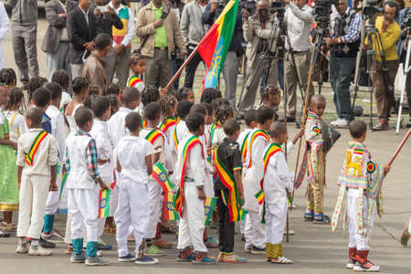 sovereignty: Addis Ababa  May 5: Young children dressed in colourful traditional outfit perform in front of the Ethiopian President at the 74th anniversary of Patriots Victory day commemorating the defeat of the invading Italians on May 5 2015 in Addis Ababa Ethiopia