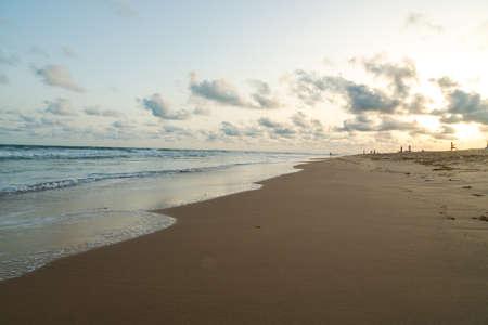 Waves of the Atlantic Ocean landing on the shores of Obama Beach in Cotonou, Benin