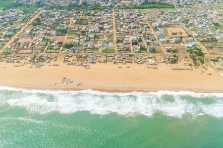 Aerial view of the Atlantic Ocean coastline along the shores of Cotonou, Benin
