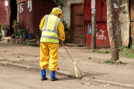 cleaning crew: Addis Ababa - July 26: A member of the city cleaning crew sweeps the streets with a broom on July 26, 2015 in Addis Ababa, Ethiopia.