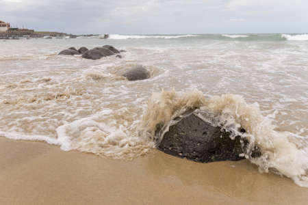 Waves of the Atlantic ocean hitting the beaches along the shores of Dakar, Senegal