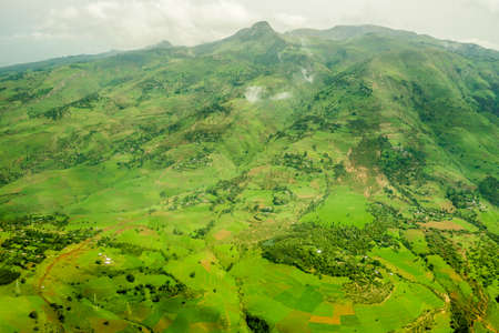 addis: Highlands surrounding Addis Ababa covered with lush green grass and vegetation Stock Photo