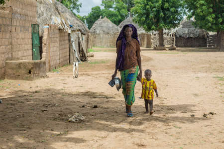 routines: Senegal - August 19: The daily routines of a young Senegalese woman from the villages of the eastern part of Senegal. August 19,2015 in a rural areas of Senegal