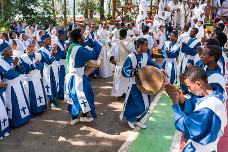 chant: ADDIS ABABA, ETHIOPIA - May 21: A young member of the Ethiopian Orthodox Church Choir sing and chant accompanied by a drum during a colorful procession on May 21, 2016 in Addis Ababa, Ethiopia