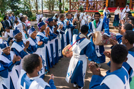 ADDIS ABABA, ETHIOPIA - May 21: A young member of the Ethiopian Orthodox Church Choir sing and chant accompanied by a drum during a colorful procession on May 21, 2016 in Addis Ababa, Ethiopia