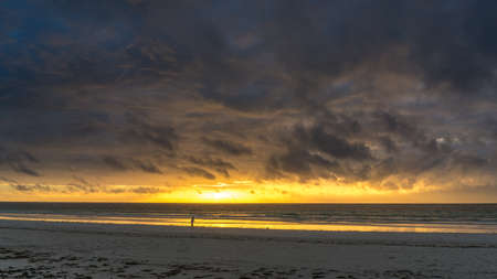 diana: Beautiful sunrise behind the thunderous clouds over the white sand beaches of Diana Beach in Mombasa Kenya