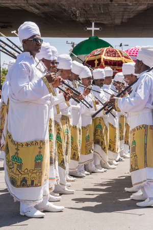 Addis Ababa - Jan 19: Clergymen sing and chant while accompanying the Tabot, a model of the arc of covenant, during a colorful procession which is part of Timket celebrations of Epiphany, on JJanuary 19, 2017 in Addis Ababa, Ethiopia.