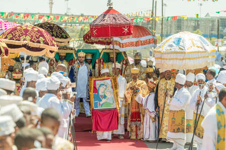 Addis Ababa - Jan 19: Priests, accompanied by Clergy, carry the Tabot, a model of the Arc of Covenant, during a colorful procession of Timket celebrations of Epiphany, commemorating the baptism of Jesus, on January 19, 2017 in Addis Ababa, Ethiopia.