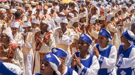Addis Ababa - Jan 19: Ethiopian Orthodox Clergy and followers sing and chant while accompanying the Tabot, a model of the arc of covenant, during a colorful procession which is part of Timket celebrations of Epiphany, on JJanuary 19, 2017 in Addis Ababa,