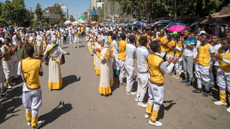 Addis Ababa - Jan 19: Ethiopian Orthodox Clergy and followers sing and chant while accompanying the Tabot, a model of the arc of covenant, during a colorful procession which is part of Timket celebrations of Epiphany, on January 19, 2017 in Addis Ababa, E