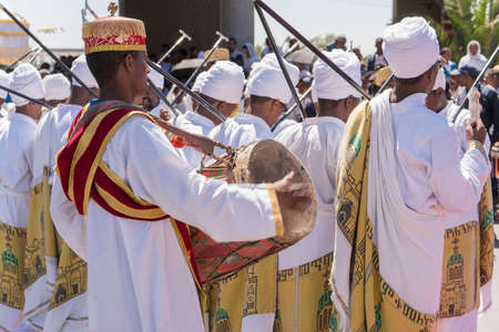 Addis Ababa - Jan 19: Clergy accompany the singing and chanting of Ethiopian Orthodox followers with kebero, a traditional drum made out of animal hide, during Timket celebrations of Epiphany, on January 19, 2017 in Addis Ababa, Ethiopia.