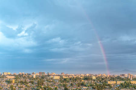 Aerial view of the Capital City of Ethiopia, Addis Ababa, with a rainbow in the sky
