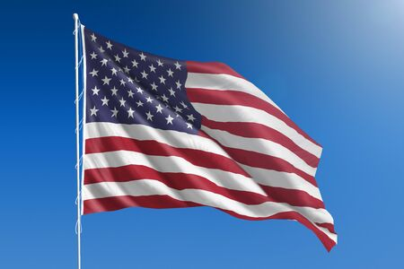 Flag of United States in front of a clear blue sky Foto de archivo