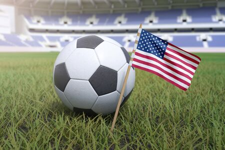 American flag in stadium field with a soccer football