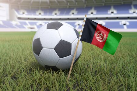 Afghanistan flag in stadium field with soccer football Foto de archivo