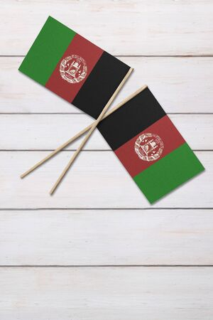 Two flags on a painted wood background Foto de archivo