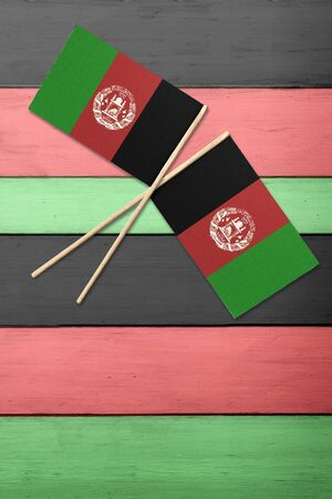 Two Afghanistan flags on a painted wood background Foto de archivo