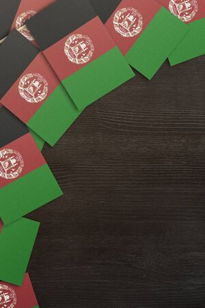 small flags framing a wood texture background with copy space Foto de archivo