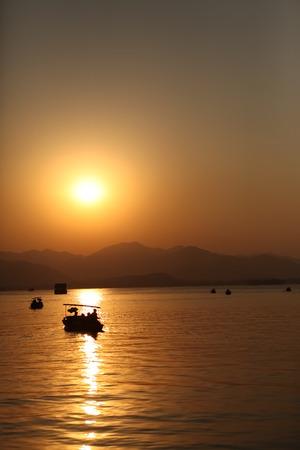 sculling: Lake sunset Stock Photo