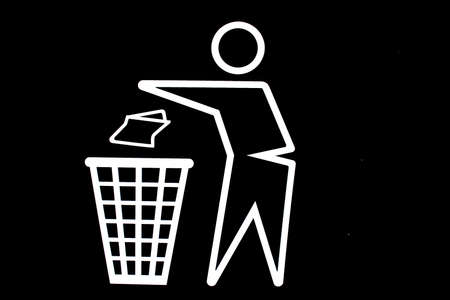 a white stickman throwing trash into garbage can on black background Reklamní fotografie - 6695266