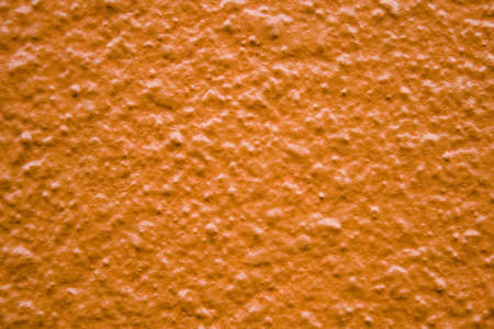 an orange shiny textured and bumpy wall 版權商用圖片