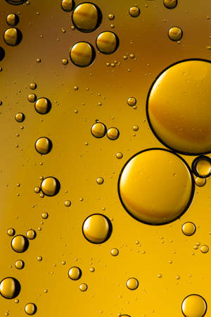 floating: Yellow oil and water abstract