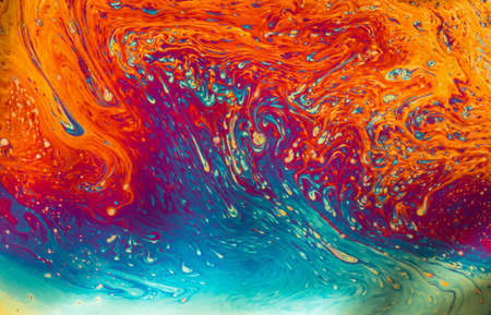 macro film: Psychedelic patterns formed on the surface of soap bubbles Stock Photo