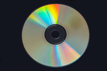 recordable media: Colors reflecting off a cd isolated on black