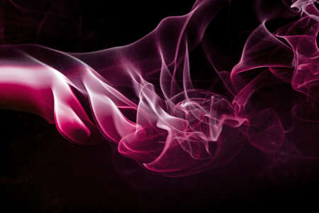 Colored smoke isolated on a black background Stock Photo