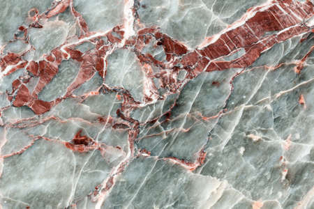 Closeup of polished red and gray natural stone, granite, marble