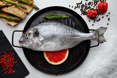 sparus: Raw dorada fish with ingredients