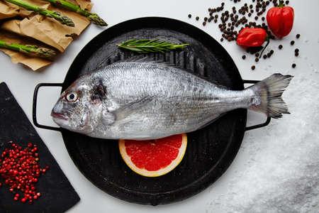 demersal: Raw dorada fish with ingredients