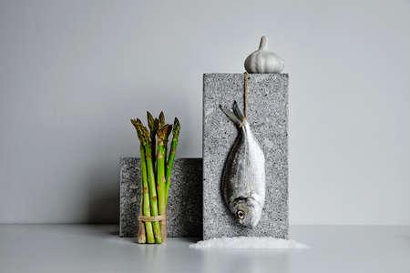 dorada: Dorada with asparagus and garlic and sea salt presented on stone