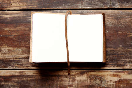 notebook: open notebook with leather cover on a wooden table from above