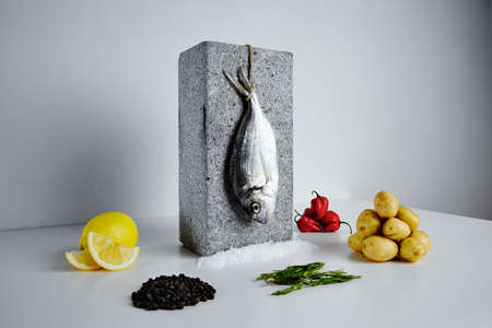 dorada: Dorada fish with aromatic herbs, spices and vegetables - healthy food, diet or cooking concept