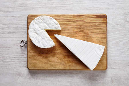 formagi: Cheese art camembert brie wooden desk white table top view