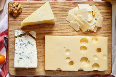 formagi: four cheeses closeup on wooden board Stock Photo