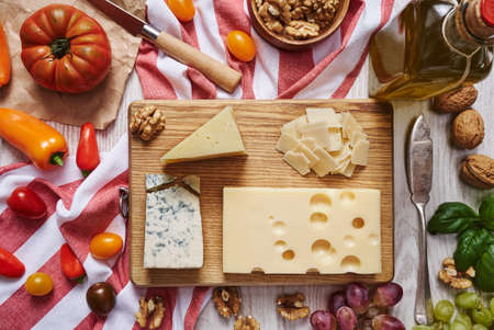 suppliers: Cheese plate with vegetables and suppliers top view