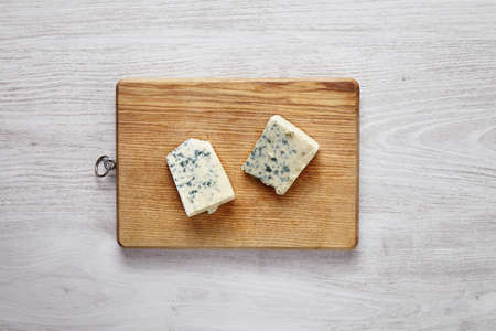 formagi: gorgonzola, roquefort, soft cheese with green moss isolated on brown desk on brushed white table top view
