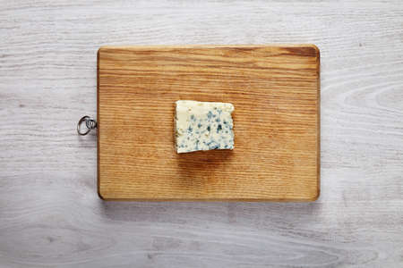 formagi: One piece of fresh roquefort cheese on wooden board