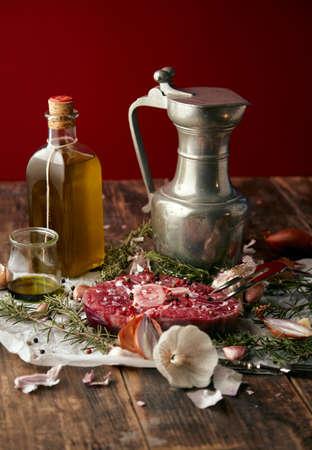Food: onions, romero, meat steak, salt, pepper, garlic, olive oil,fork, sauses