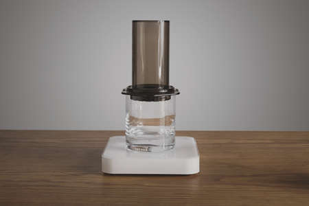 automat: Step by step aero press coffee preparation Aeropress mounted on transparent whiskey rox glass Professional coffee brewing cafe shop