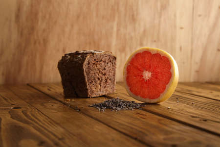 artisan bakery: Exotic lavender grapefruit brown bread alternatively baked in artisan bakery presented on wooden table and rustic background