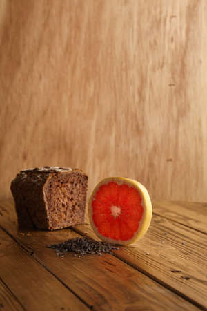 artisan bakery: Exotic lavender grapefruit bread alternatively baked in artisan bakery presented on wooden table and rustic background