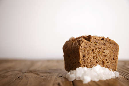 artisan bakery: Organic homemade bread with sea salt presented on wooden rustic background