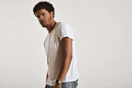 unlabeled: Sexy muscular African American man in white unlabeled cotton t-shirt turning sideways and looking into the camera