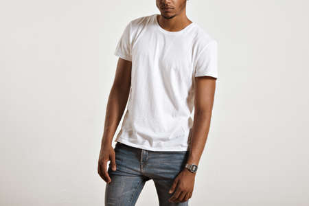 Unlabeled white cotton t-shirt presented on a muscular body of a young athlete Imagens