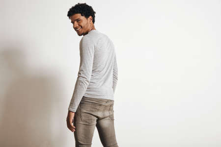 latino man: Back view of attractive latino man looking with happy smile in camera turning around, isolated on white, wearing blank heather grey clothing LANG_EVOIMAGES